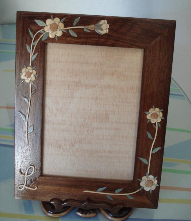 Portarretratos con motivos florales